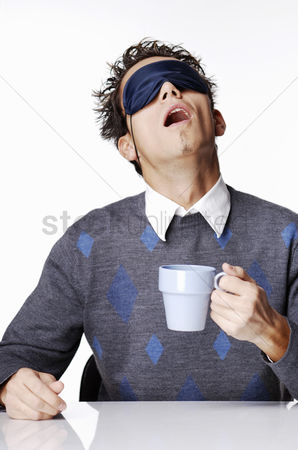 Funny : Man with eye mask holding a cup of coffee