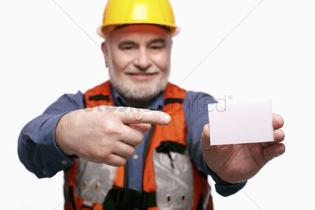 Leadership : Man with hardhat pointing at a business card