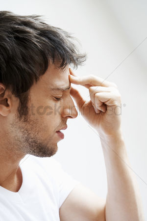 Pain : Man with headache touching forehead