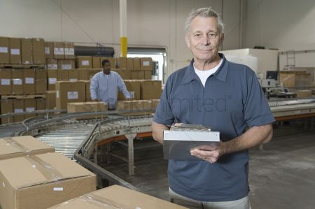 Interior background : Man working in distribution warehouse