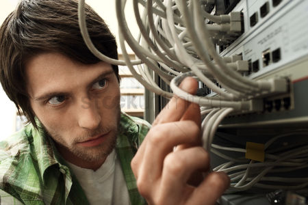 Fixing : Man working on network switch close-up