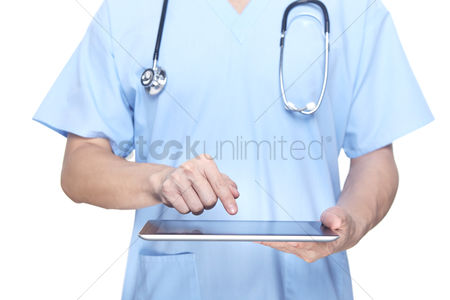 Finger : Medical personnel using a tablet