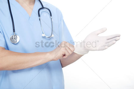 Medical personnel : Medical personnel wearing rubber gloves