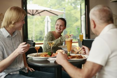 Having fun : Men and woman having lunch together