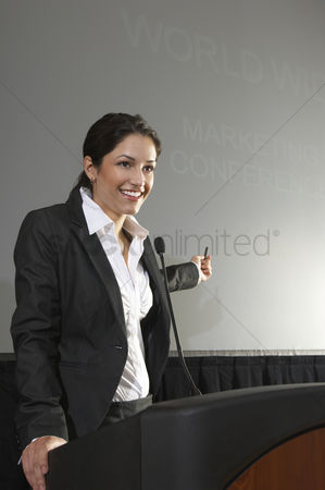 Ponytail : Mid adult woman lecturing