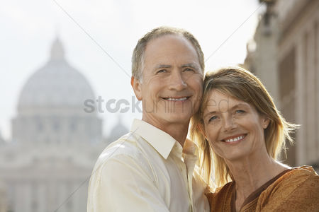 Cheerful : Middle-aged couple hugging in rome italy front view portrait