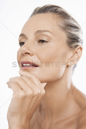 Contemplation : Middle-aged woman hand on chin