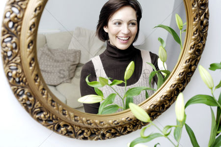Housewife : Mirror reflection of woman smiling