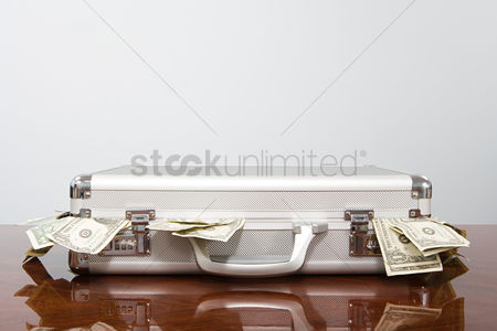 Interior background : Money in a briefcase