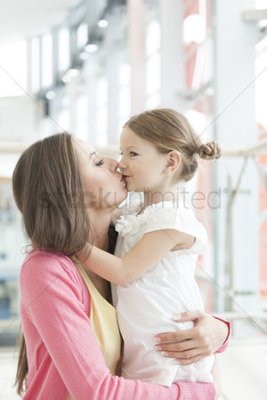 Kissing : Mother and daughter hug and kiss