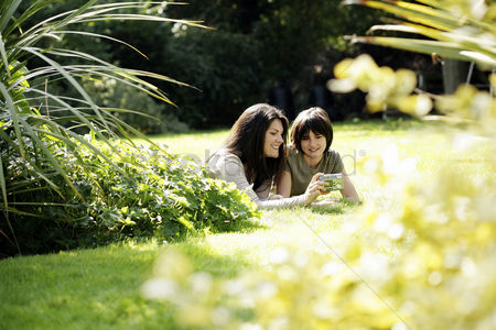 Outdoor : Mother and daughter taking picture together