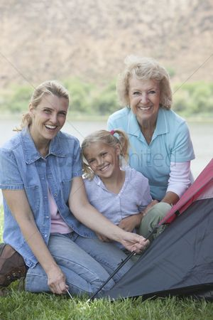 Pitch : Mother daughter and grand-daughter putting up a tent