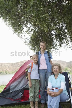Pitch : Mother daughter and grand-daughter stand outside tent