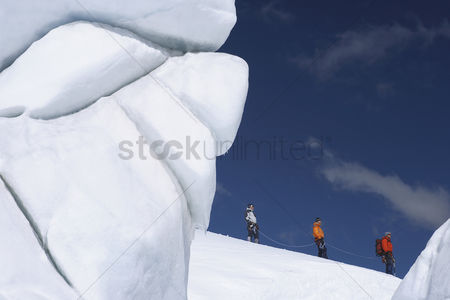 Rope : Mountain climbers hiking past ice formation