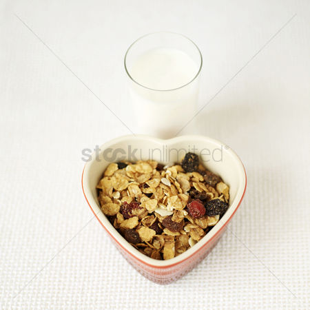 Bowl : Muesli in heart bowl with a glass of milk