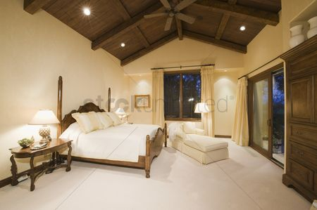 High ceiling : Neutral bedroom with high wooden ceiling