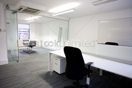 Tidy : Office desk with meeting room in background