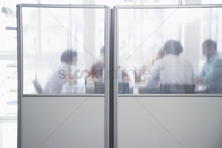 Office worker : Office workers meeting behind cubicle wall in office