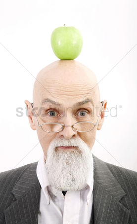 Bald : Old professor with a green apple on top of his head