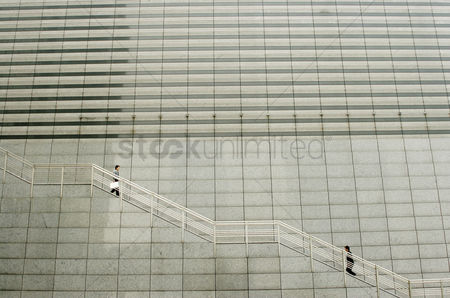 Staircase : One man going up while the other going down the stairs