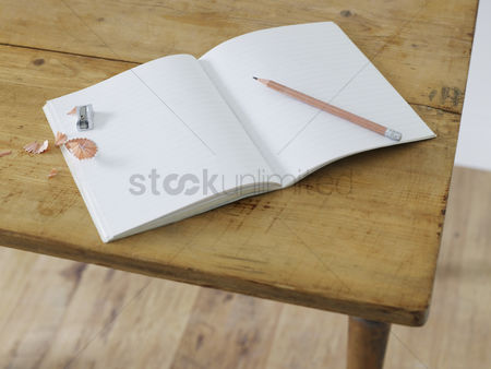 Notebook : Open notebook with pencil and pencil sharpener on table elevated view