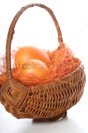 Easter : Orange easter eggs in basket
