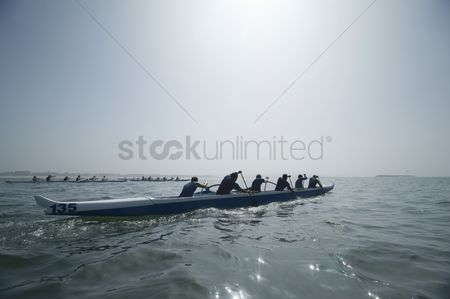 Appearance : Outrigger canoeing team on water