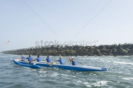 Flag : Outrigger canoeing team on water