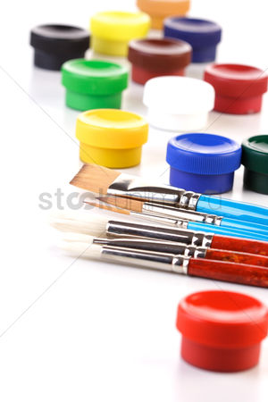 Creativity : Paint boxes and brushes on white background