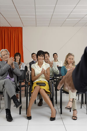 Learning : People applauding a speaker in conference room