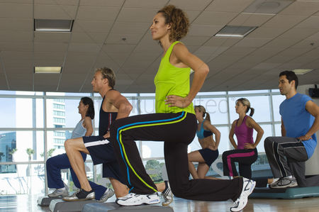 Physical : People exercising in step aerobics class