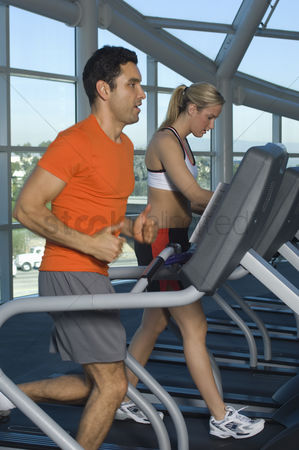 Workout : People exercising on treadmills in health club
