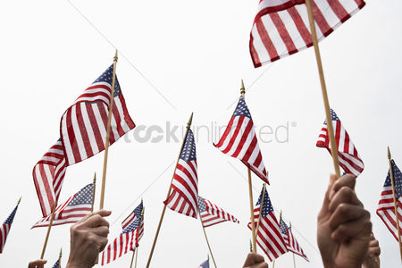Flag : People holding up american flags high section