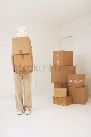 Pile : Person carrying moving boxes
