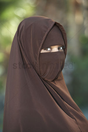 Traditional clothing : Portarit of young woman in brown niqab