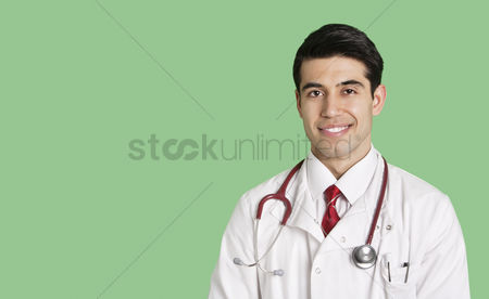 Head shot : Portrait of a happy male doctor in lab coat over green background
