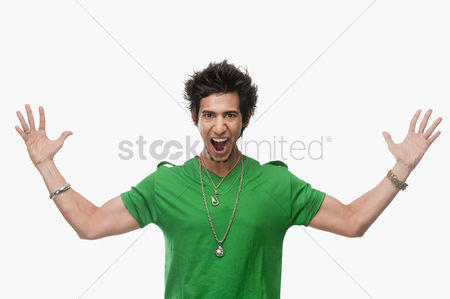 Accessories : Portrait of a man shouting with arm outstretched