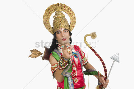 God : Portrait of a stage artist dressed-up as rama the hindu mythological character and pointing