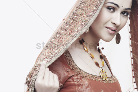 Traditional clothing : Portrait of a young woman in traditional clothing smiling