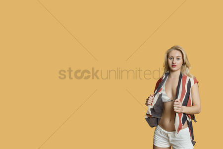 British ethnicity : Portrait of a young woman with british flag over colored background