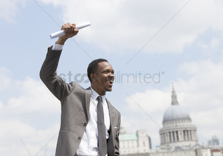 Celebrating : Portrait of afircan american businessman celebrating