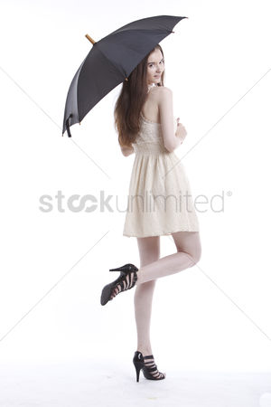 Beautiful people : Portrait of beautiful young woman in dress with umbrella against white background