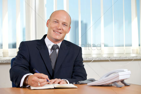 Bald : Portrait of businessman working at office