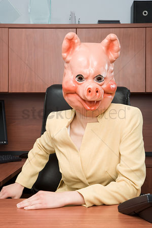 Interior : Portrait of businesswoman in a pig mask
