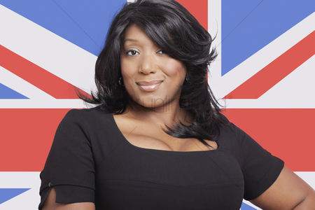 Respect : Portrait of casual mixed race woman against british flag