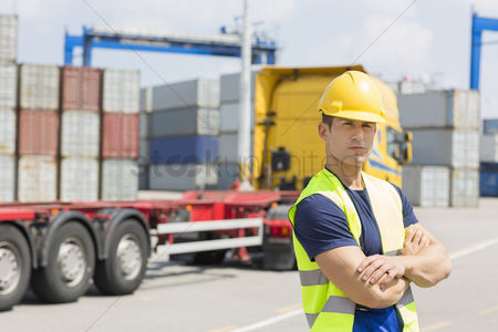 Truck : Portrait of confident mid adult man in shipping yard