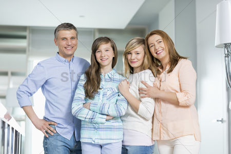 Three quarter length : Portrait of happy family with children standing together at home