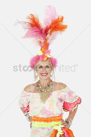1f4a21b20381 1918008 Brazilian culture   Portrait of happy senior woman in brazilian  outfit over gray background