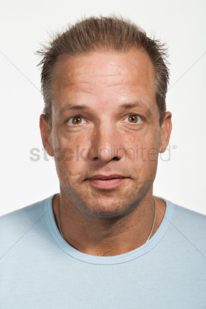 Sullen : Portrait of mid adult caucasian man