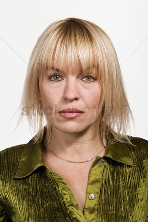 Sullen : Portrait of mid adult caucasian woman